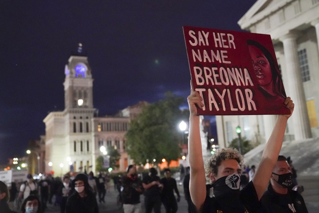 Protesters march, Thursday, Sept. 24, 2020, in Louisville, Ky. Authorities pleaded for calm while activists vowed to fight on Thursday in Kentucky's l...