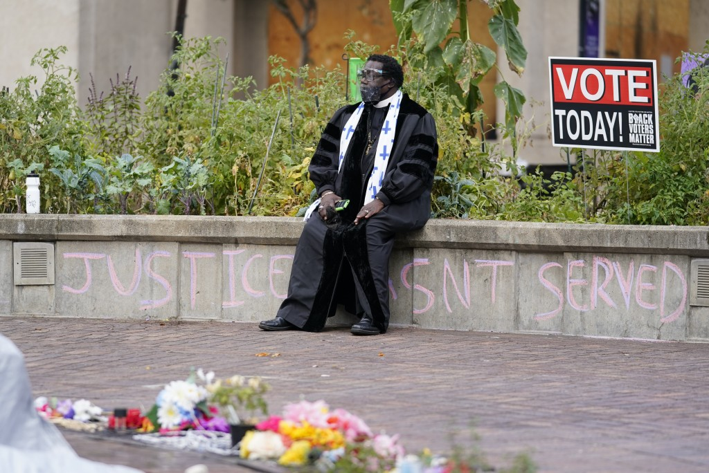 Rev. Raymond Johnson sits at Jefferson Square Park where a makeshift memorial has been set up in honor of Breonna Taylor, Thursday, Sept. 24, 2020, in...