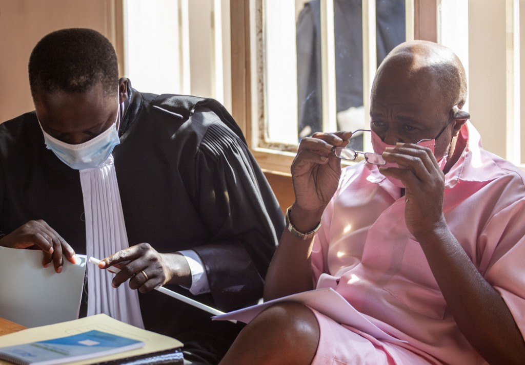 "Paul Rusesabagina, right, whose story inspired the film ""Hotel Rwanda"", wears a pink prison uniform as he appears for a bail hearing at a court in the..."