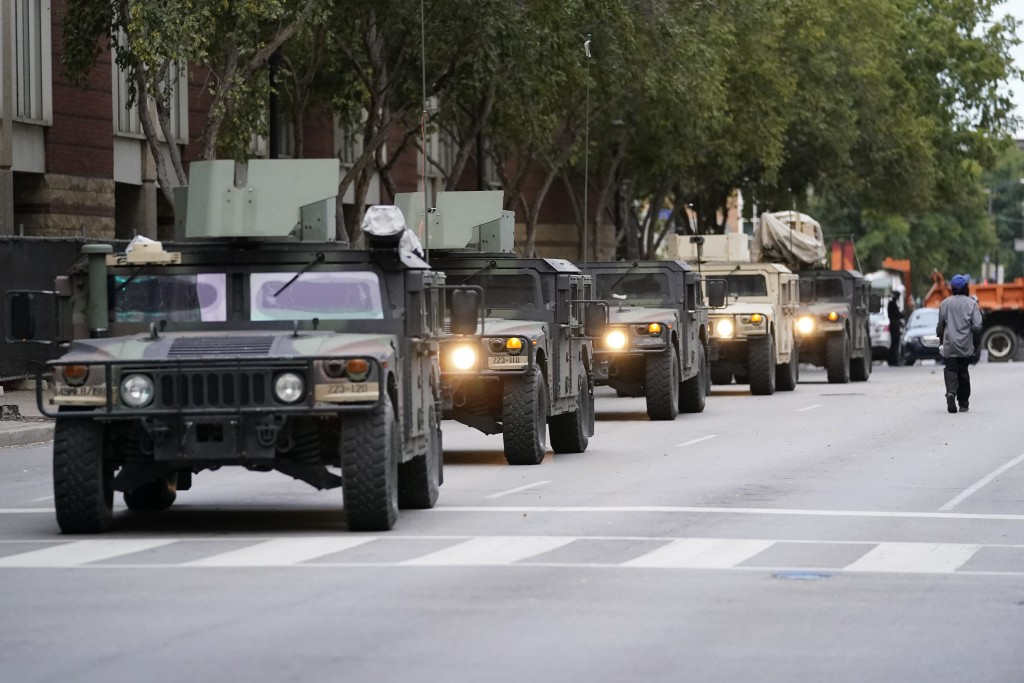 Kentucky National Guard troops arrive, Thursday, Sept. 24, 2020, in Louisville, Ky. Authorities pleaded for calm while activists vowed to fight on Thu...