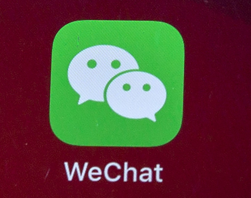 FILE - Icons for the smartphone apps WeChat are seen on a smartphone screen in Beijing, on Aug. 7, 2020.  The Justice Department is asking a judge to ...