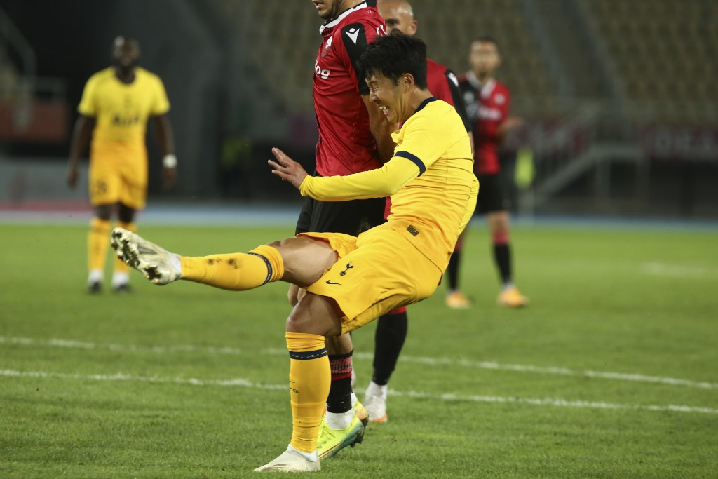 Tottenham's Son Heung-min, scores the second goal of his team during a Europa League third qualifying round soccer match between Shkendija and Tottenh...
