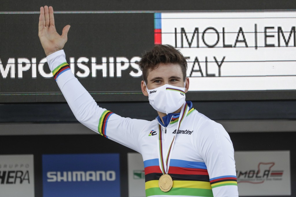 Italy's Filippo Ganna celebrates on the podium after winning the men's Individual Time Trial event, at the road cycling World Championships, in Imola,...