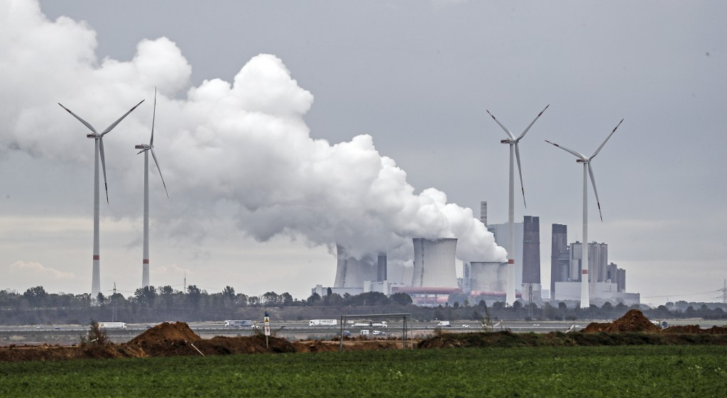 A coal fired power station steams near the Garzweiler surface coal mine in Germany, Friday, Sept. 25, 2020. Several groups like 'Friday for Future' or...
