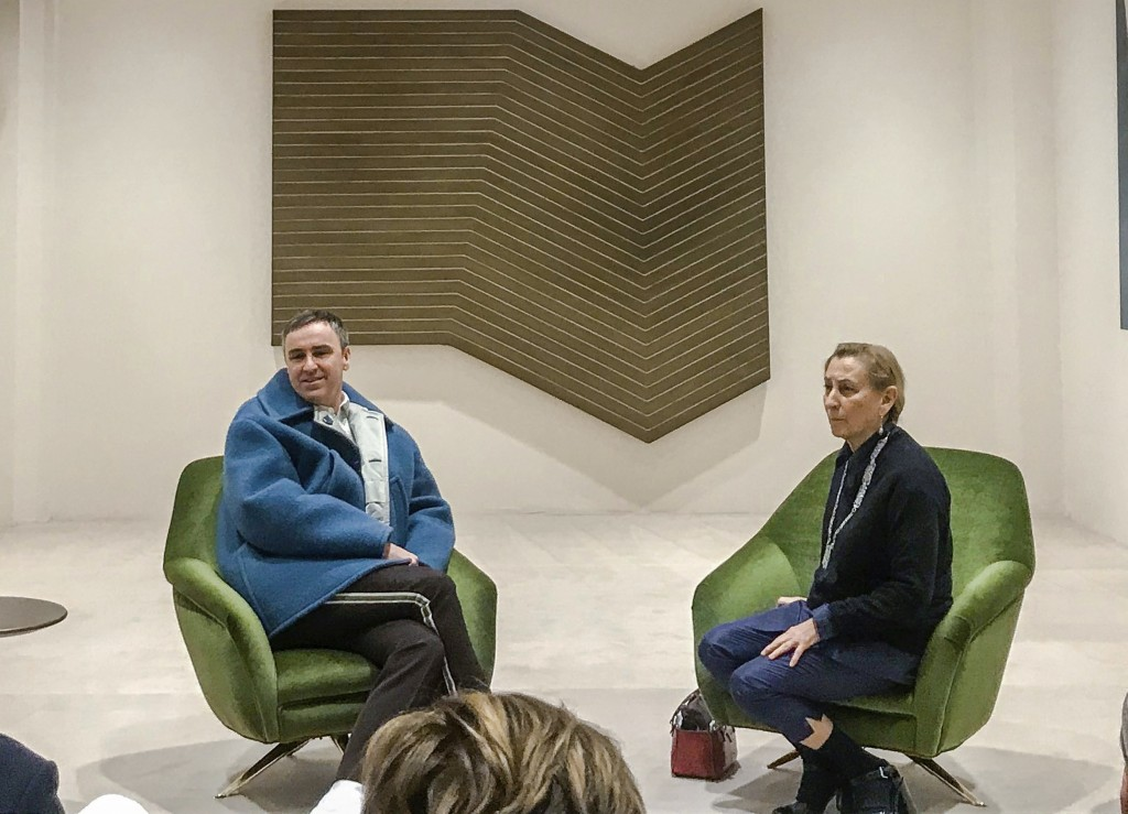 FILE - In this Sunday, Feb. 23, 2020 file photo, Miuccia Prada and Raf Simons, left, hold a press conference in Milan, Italy, on the sidelines of the ...