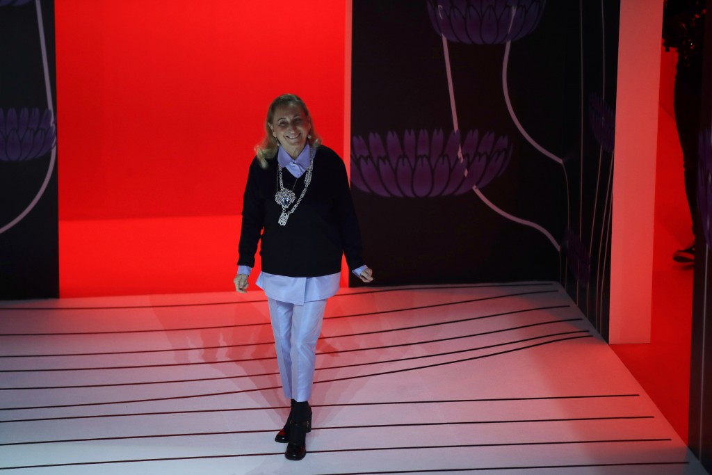 FILE - In this Thursday, Feb. 20, 2020 file photo, Miuccia Prada acknowledges the applauses at the end of her Prada women's Fall-Winter 2020-2021 fash...