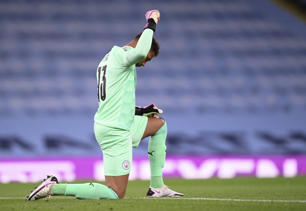 Manchester City's goalkeeper Zack Steffen gestures prior to the start of the English League Cup third round soccer match between Manchester City and B...