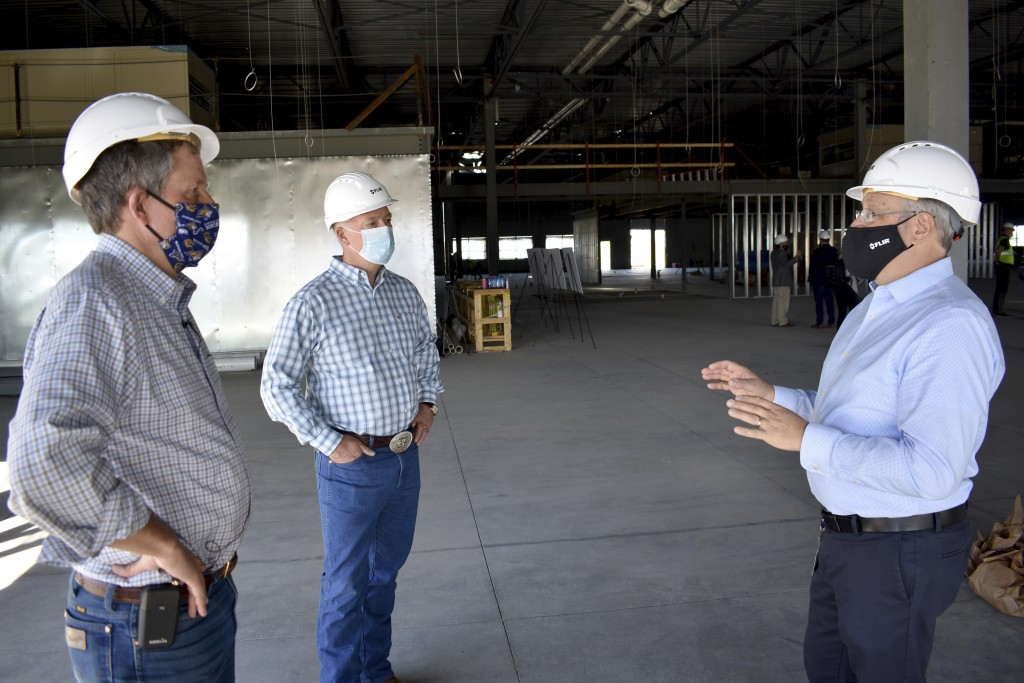 Republicans U.S. Sen. Steve Daines, left, and Rep. Greg Gianforte listen to a representative of FLIR Systems describe the technology company's new fac...