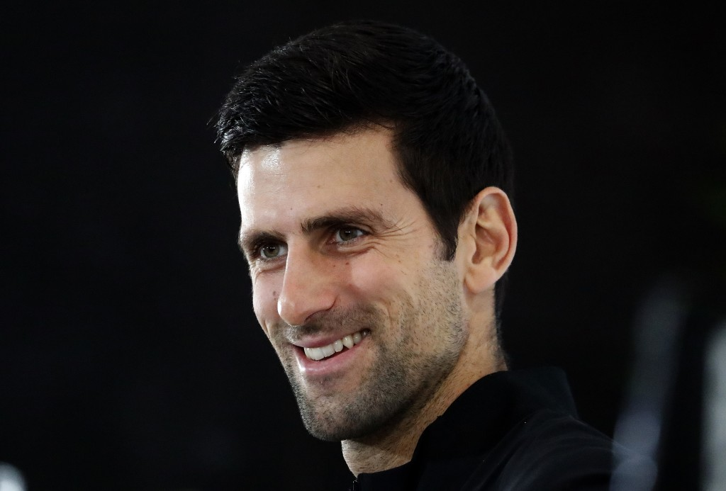 FILE - In this Friday, Nov. 9, 2018, file photo, Novak Djokovic of Serbia speaks during a press conference before the official launch of the ATP Tenni...