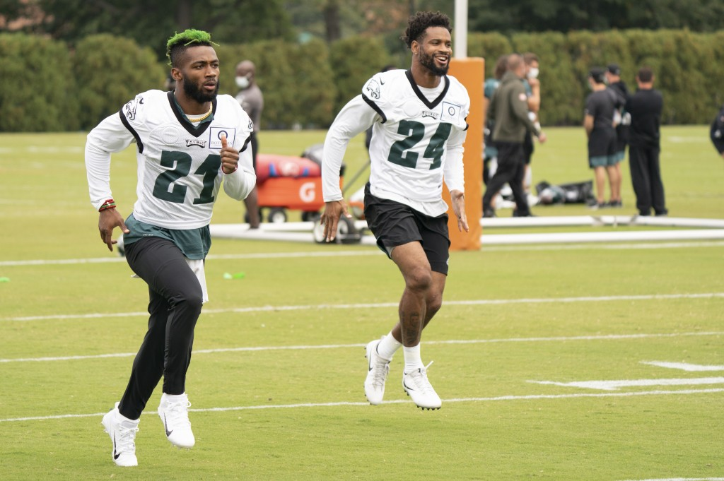 Philadelphia Eagles safety Jalen Mills, left, warms up with cornerback Darius Slay, right, during an NFL football practice, Thursday, Sept. 24, 2020, ...