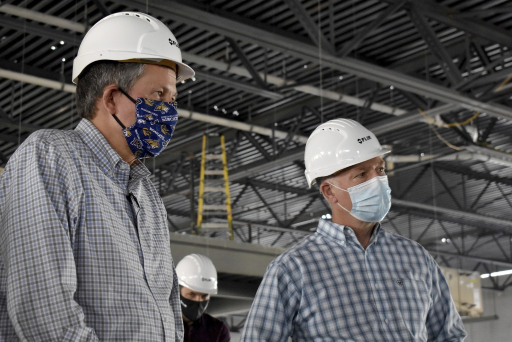 Republicans U.S. Sen. Steve Daines, left, and Rep. Greg Gianforte are seen touring a technology company facility under construction on Wednesday, Sept...