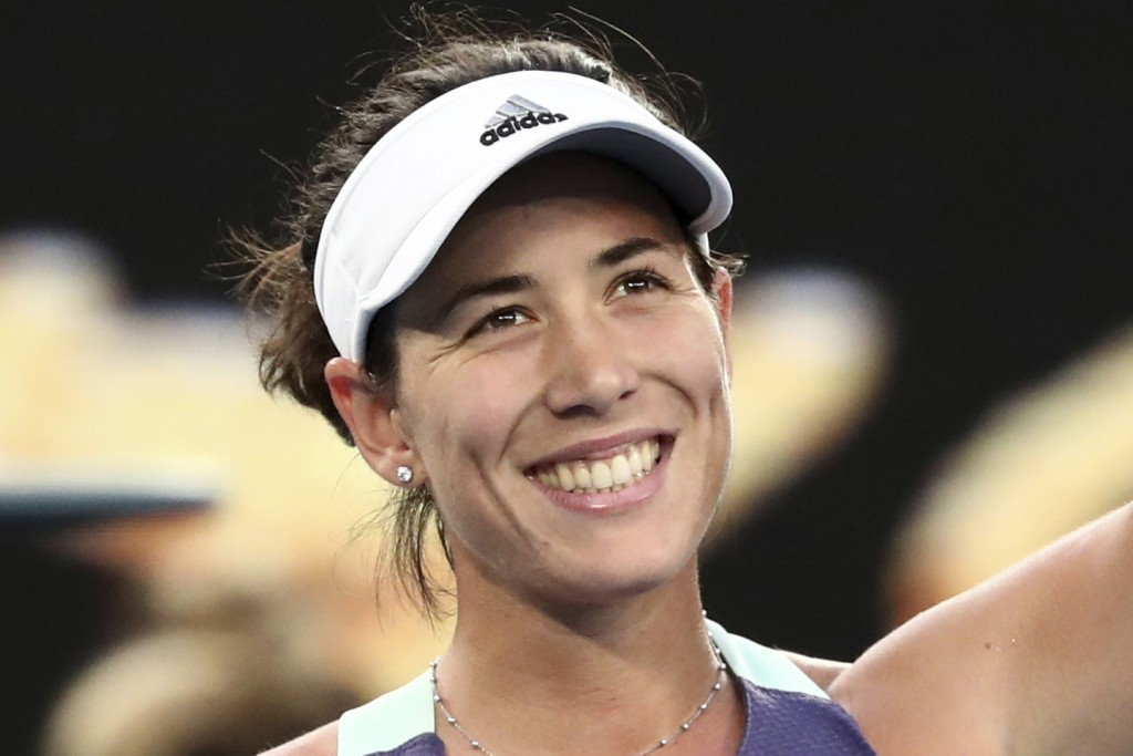 FIULE - In this Jan. 25, 2020, file photo, Spain's Garbine Muguruza smiles after defeating Ukraine's Elina Svitolina in their third round singles matc...