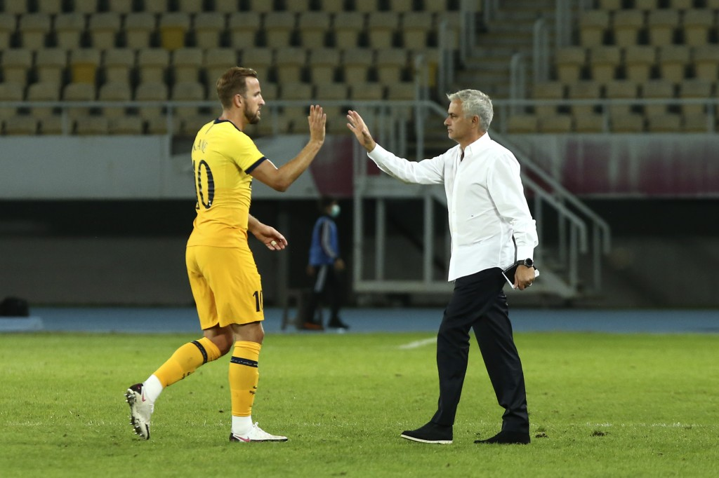 Tottenham's manager Jose Mourinho, right, celebrates with his player Harry Kane after the end of a Europa League third qualifying round soccer match b...