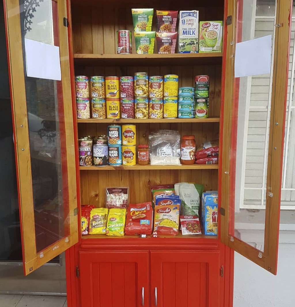 In this July 19, 2020 photo provided by Rick Everett, a free food pantry sits outside his home in Sydney, Australia, where he offers coffee, home-cook...