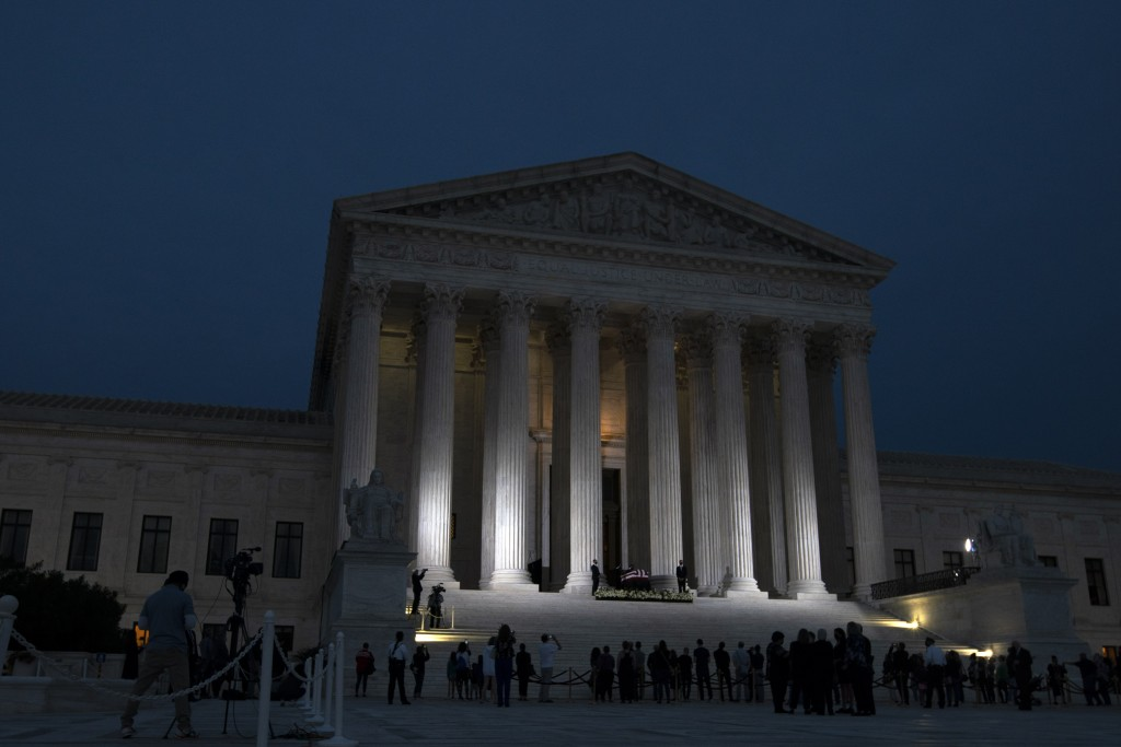 Mourners pay respects as Justice Ruth Bader Ginsburg lies in repose under the Portico at the top of the front steps of the U.S. Supreme Court building...