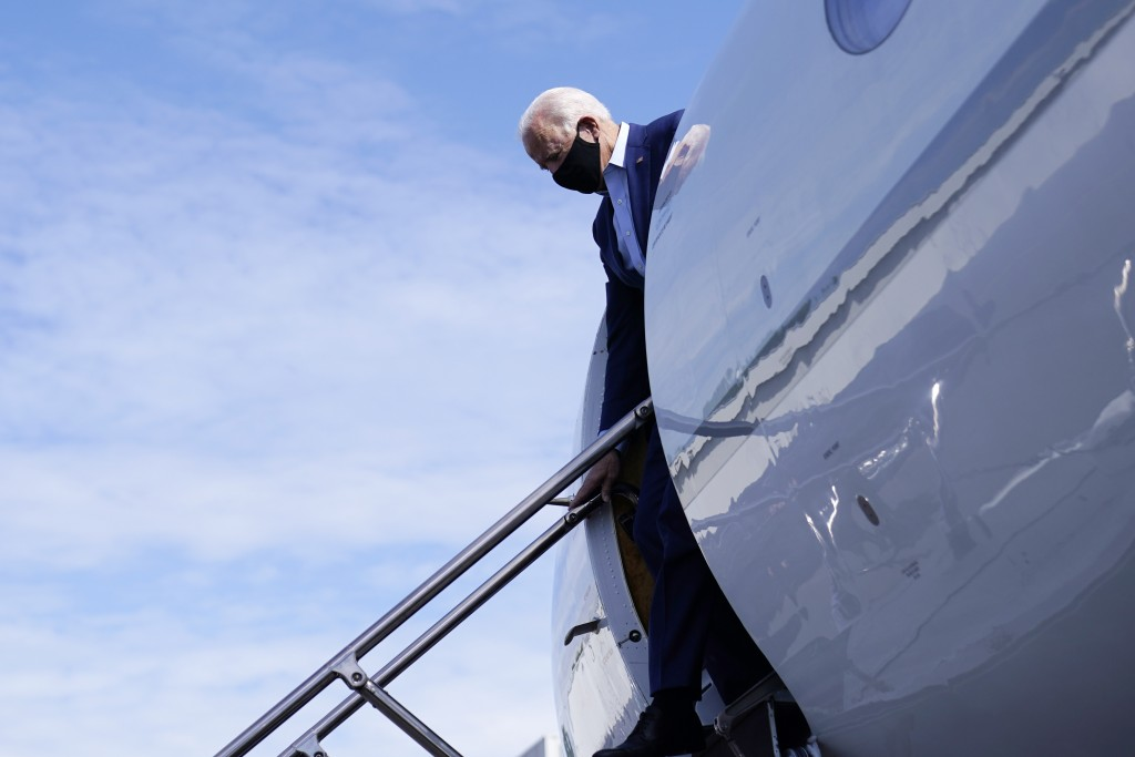 FILE - In this Sept. 23, 2020, file photo Democratic presidential candidate former Vice President Joe Biden arrives at Charlotte Douglas International...