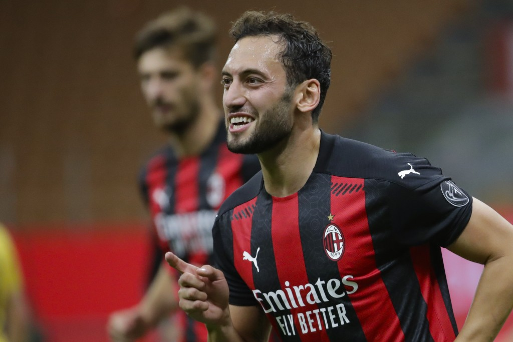 AC Milan's Hakan Calhanoglu celebrates after scoring his side's third goal during the Europa League, third-round qualifying soccer match between AC Mi...