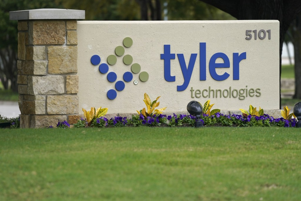 The sign for Tyler Technologies is seen outside the company's offices, Thursday, Sept. 24, 2020, in Plano, Texas. The major U.S. provider of software ...