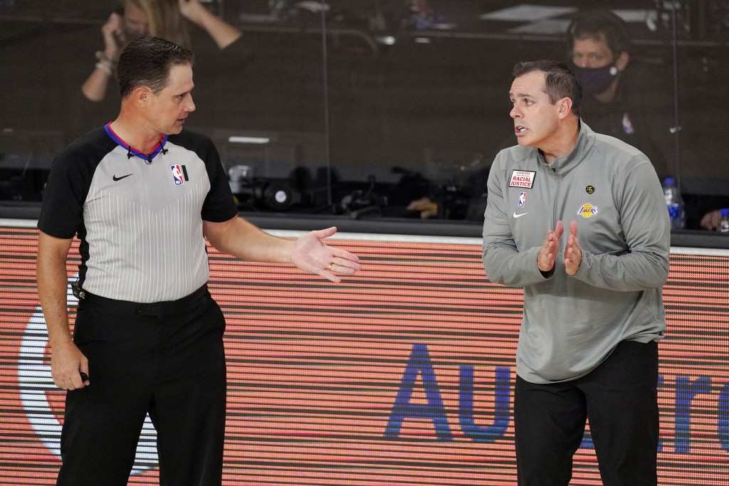 Los Angeles Lakers head coach Frank Vogel, right, talks with an official during the first half of an NBA conference final playoff basketball game agai...