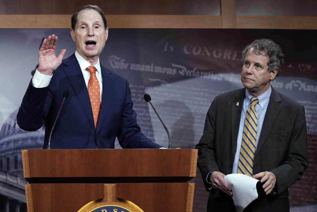 FILE - In this Wednesday, Jan. 15, 2020 file photo, Senate Finance Committee ranking member Ron Wyden, D-Ore., speaks during a news conference at the ...