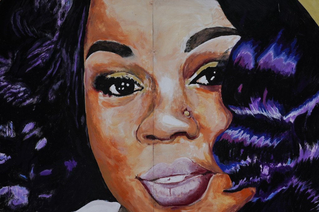 FILE - This Wednesday, Sept. 23, 2020 file photo, shows a mural of Breonna Taylor in Louisville, Ky. For months, Taylor's name has been a rallying cry...