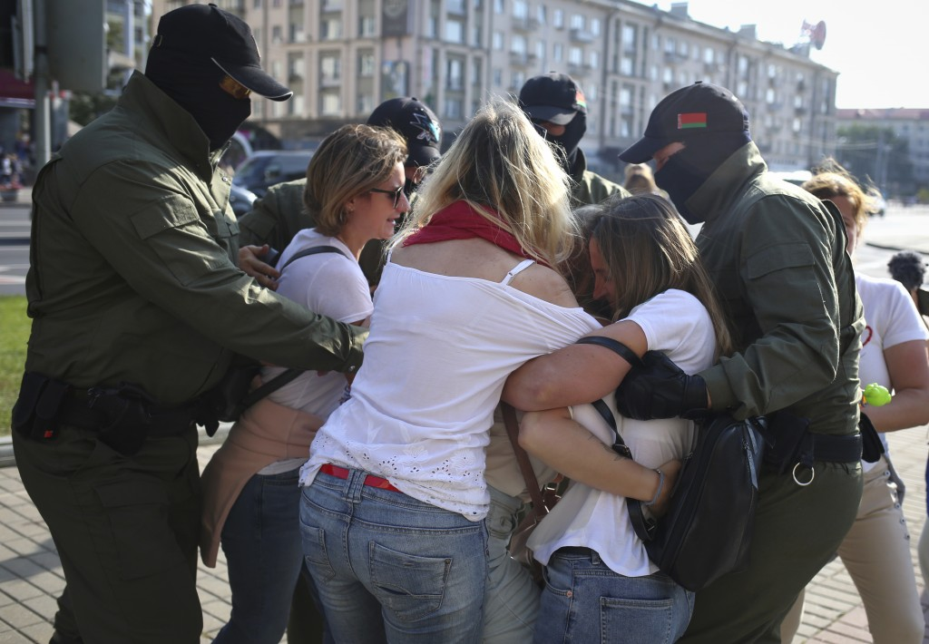 Police detain protesters during an opposition rally to protest the official presidential election results in Minsk, Belarus, Saturday, Sept. 26, 2020....