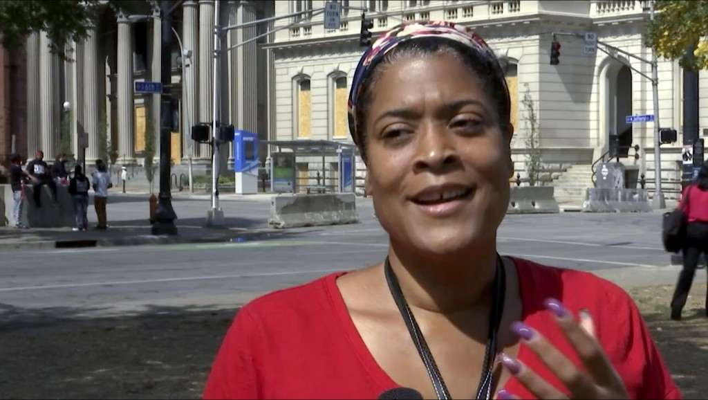In this image made from video on Sept. 24, 2020, Chea Woolfolk speaks to a reporter on the streets of Louisville, Ky. Woolfolk, is one of many demandi...
