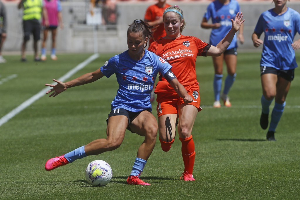 Chicago Red Stars' Sarah Gorden, front, plays the ball as Houston Dash's Bri Visalli defends during the second half of an NWSL Challenge Cup soccer fi...