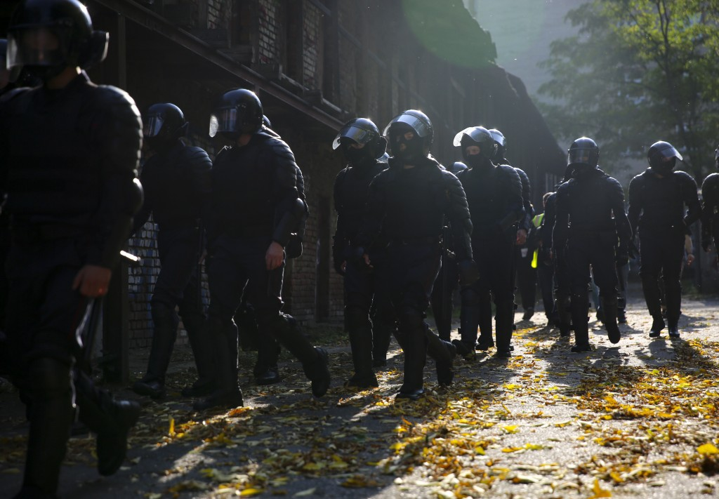 Police officer walk to detain demonstrators during an opposition rally to protest the official presidential election results in Minsk, Belarus, Saturd...