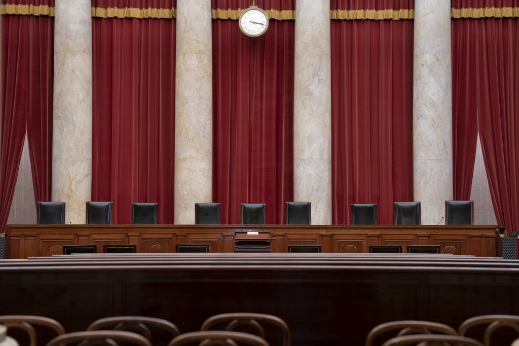 FILE - In this June 2019 file photo the empty courtroom is seen at the U.S. Supreme Court in Washington as the justices prepare final decisions of the...