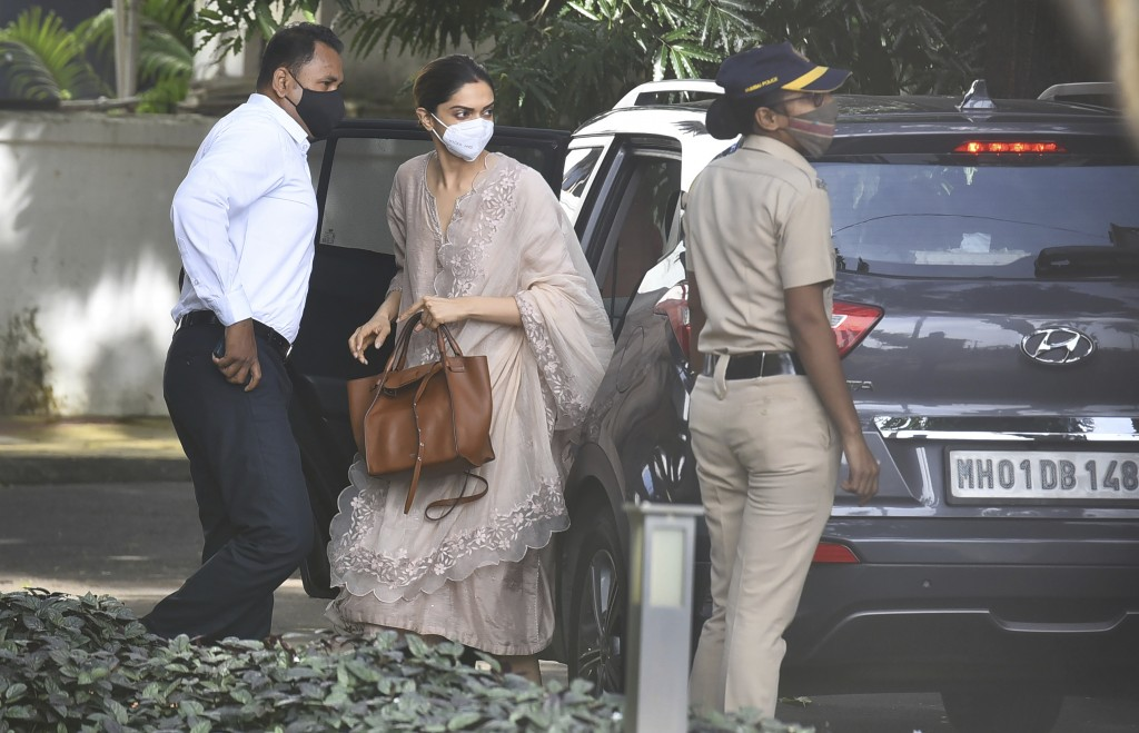 Bollywood actor, Deepika Padukone, center, arrives at the office of narcotics control board, in Mumbai, India, Saturday, Sept. 26, 2020. Bollywood sta...