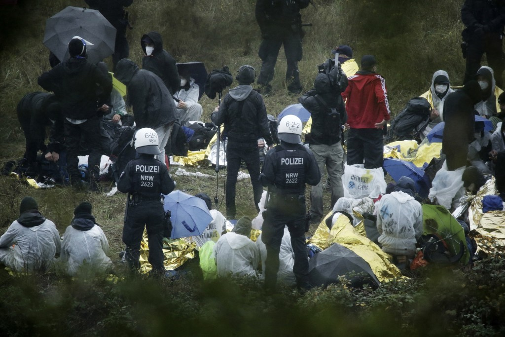 Activists are surrounded by police on the Garzweiler power plant grounds in Grevenbroich, western Germany, Saturday, Sept. 26, 2020. Anti-coal protest...