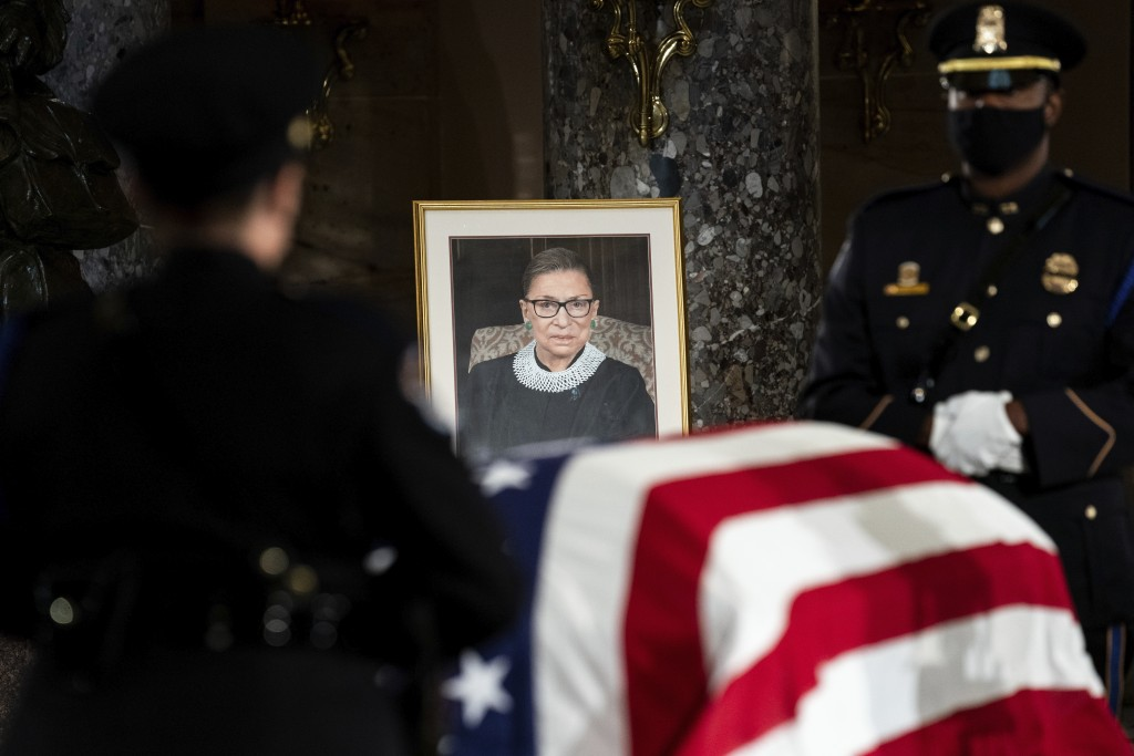 The flag-draped casket of Justice Ruth Bader Ginsburg lies in state in the U.S. Capitol on Friday, Sept. 25, 2020. Ginsburg died at the age of 87 on S...