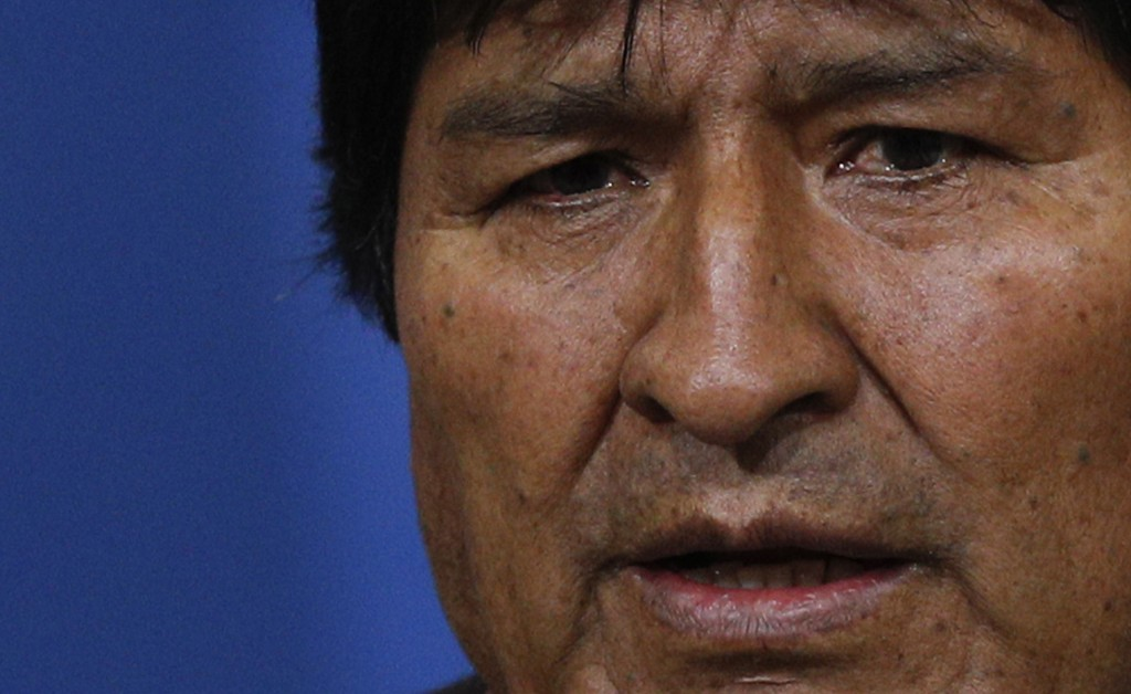 FILE - In this Nov. 10, 2019 file photo, Bolivia's President Evo Morales speaks during a press conference at the military base in El Alto, on the outs...