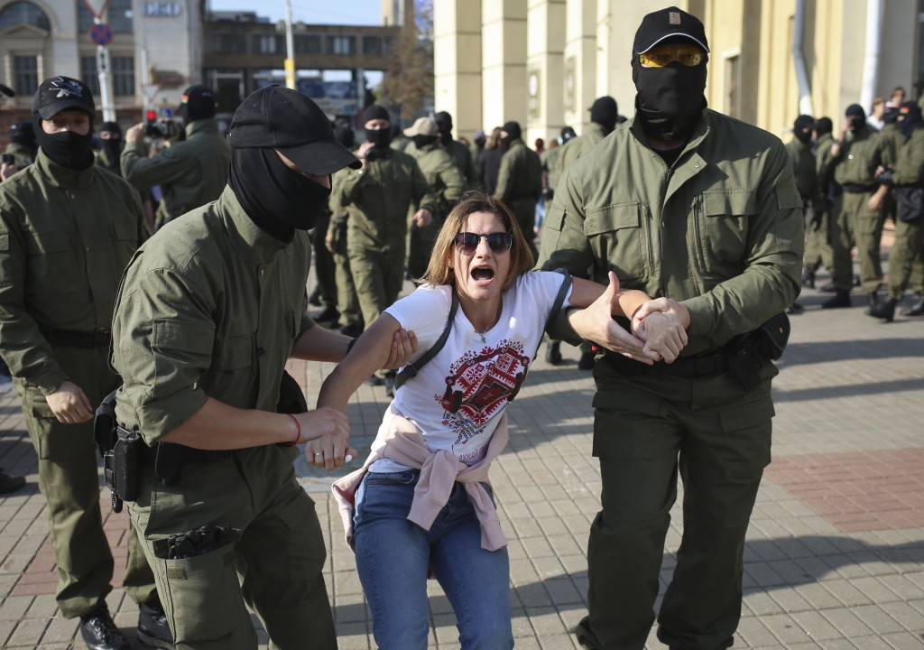 Police detain a protester during an opposition rally to protest the official presidential election results in Minsk, Belarus, Saturday, Sept. 26, 2020...