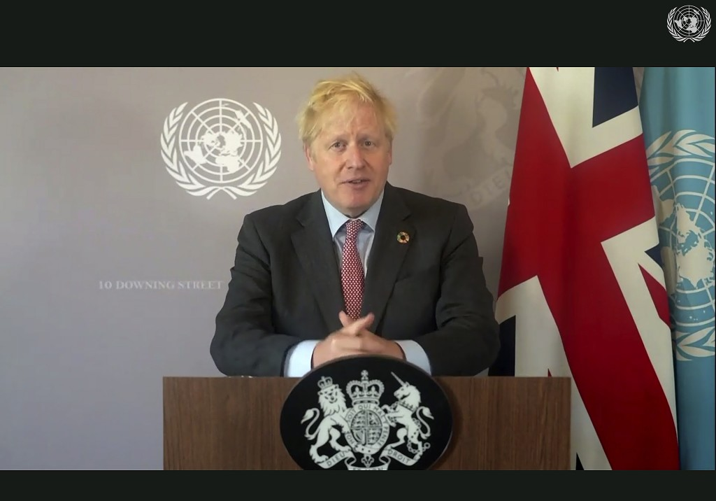 In this photo made from UNTV video, British Prime Minister Boris Johnson speaks in a pre-recorded message which was played during the 75th session of ...