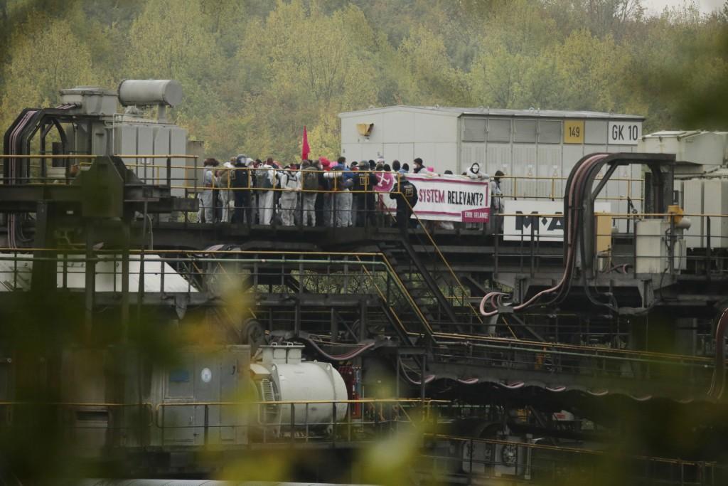 Activists block Garzweiler power plant site, a coal conveyor, in Grevenbroich, western Germany, Saturday, Sept. 26, 2020. Anti-coal protesters have en...
