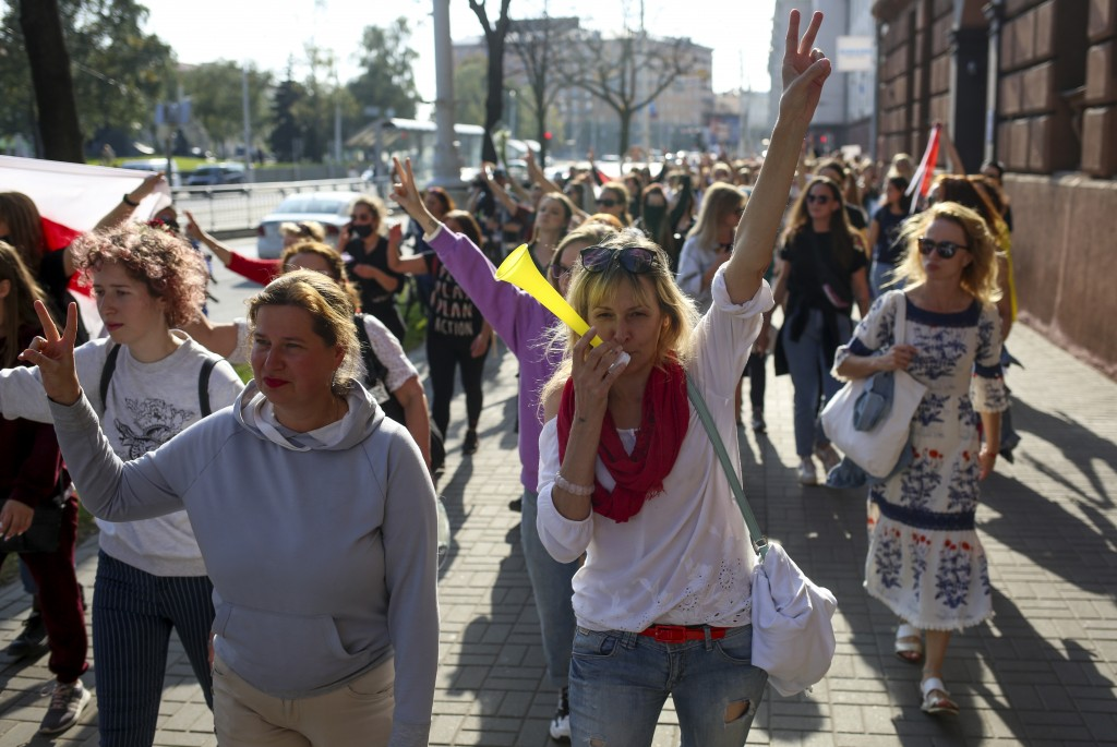 Belarusian women attend an opposition rally to protest the official presidential election results in Minsk, Belarus, Saturday, Sept. 26, 2020. Hundred...