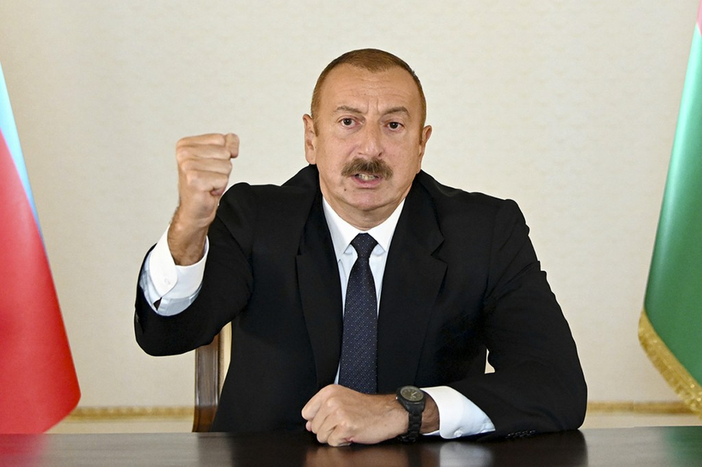 In this photo provided by the Azerbaijan's Presidential Press Office provided on Sunday, Sept. 27, 2020, Azerbaijani President Ilham Aliyev gestures a...