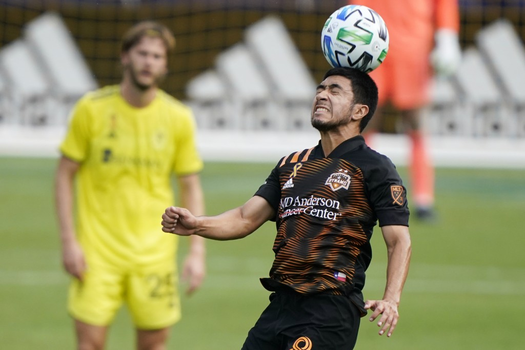 Houston Dynamo midfielder Memo Rodriguez heads the ball during the first half of an MLS soccer match against Nashville SC Saturday, Sept. 26, 2020, in...