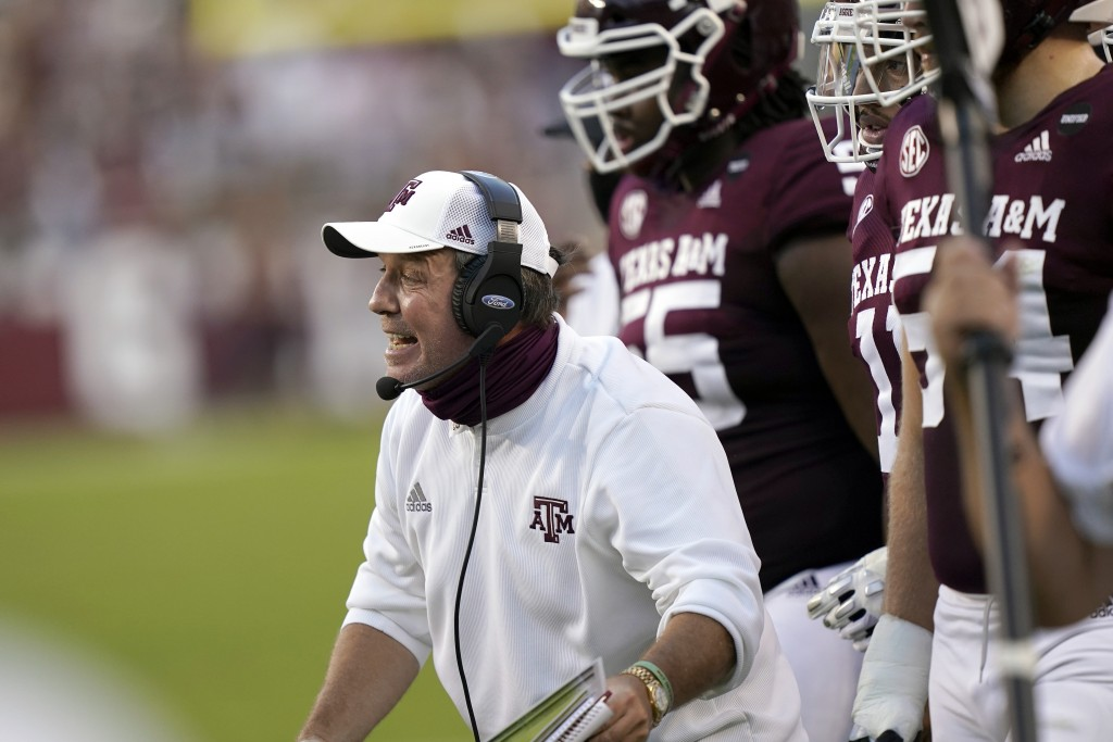 Texas A&M coach Jimbo Fisher yells to his players during the first half of an NCAA college football game against Vanderbilt Saturday, Sept. 26, 2020, ...