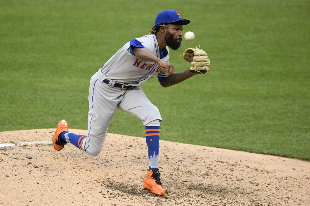 New York Mets relief pitcher Miguel Castro delivers during the sixth inning of the first baseball game of a doubleheader against the Washington Nation...
