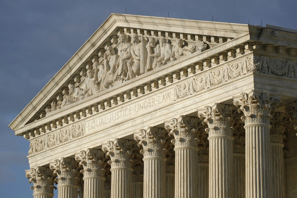 FILE - In this May 3, 2020 photo, the setting sun shines on the Supreme Court building on Capitol Hill in Washington. (AP Photo/Patrick Semansky, File...