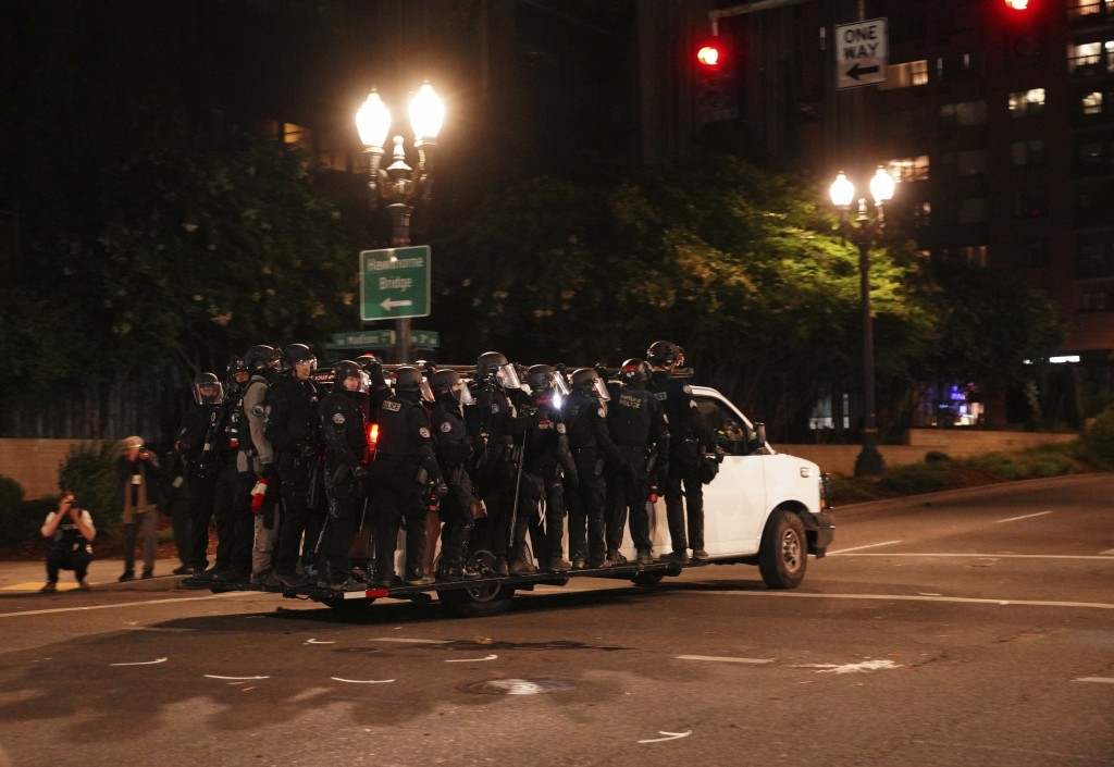 Portland Police line around a van and drive away from protesters rallying at the Mark O. Hatfield United States Courthouse on Saturday, Sept. 26, 2020...