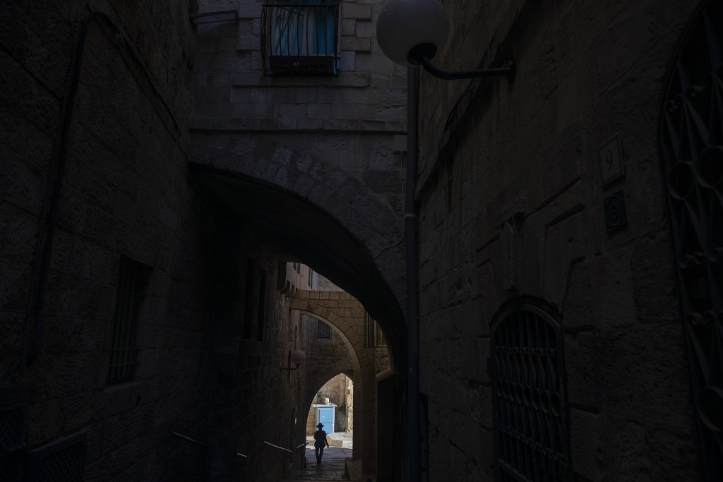 An Ultra-Orthodox Jewish man walks towards the Western Wall, the holiest site where Jews can pray in Jerusalem's old city ahead of Yom Kippur, the hol...