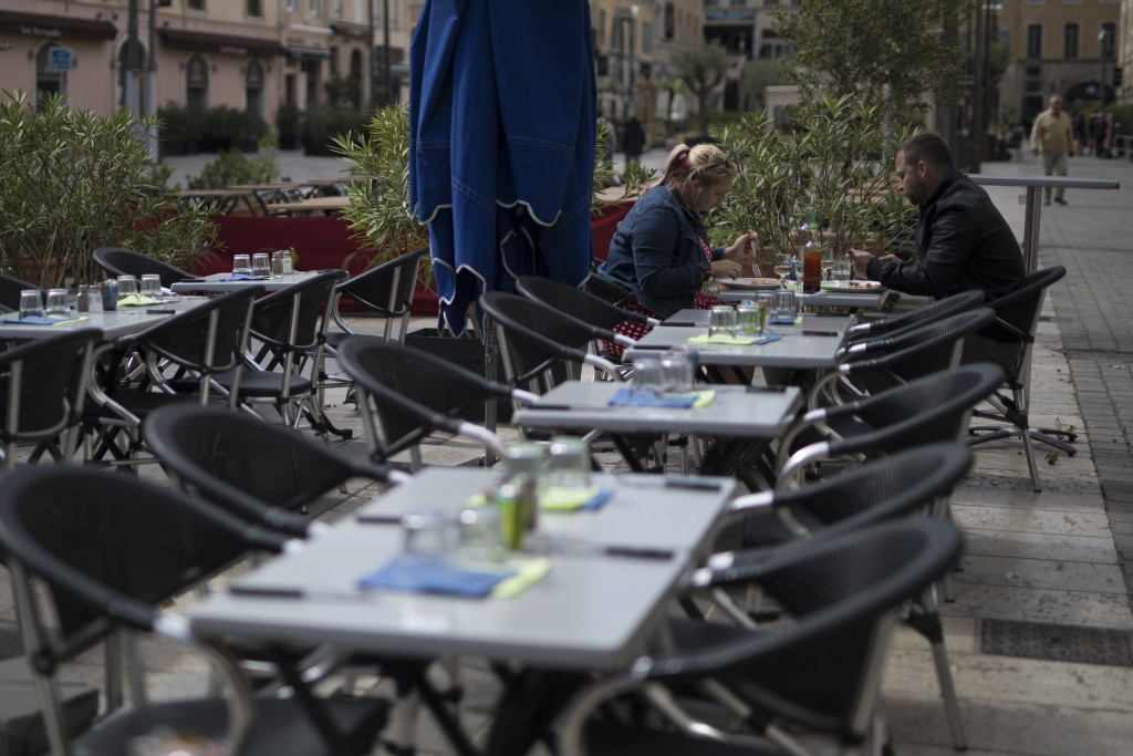 Diners eat lunch before the closure of restaurants and bars, in Marseille, southern France, Sunday Sept. 27, 2020. As restaurants and bars in Marseill...