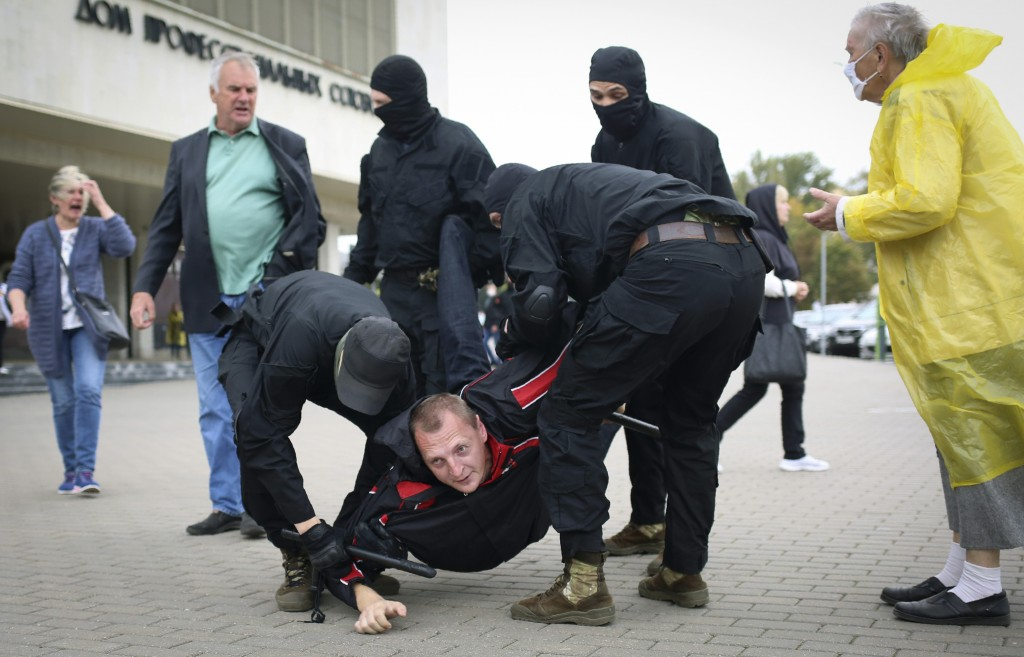 Police detain a man during an opposition rally to protest the official presidential election results in Minsk, Belarus, Sunday, Sept. 27, 2020. Hundre...