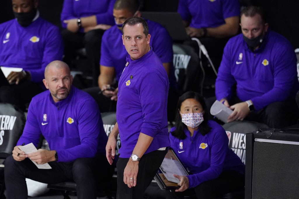 Los Angeles Lakers head coach Frank Vogel, center, watches the action during the first half of an NBA conference final playoff basketball game between...