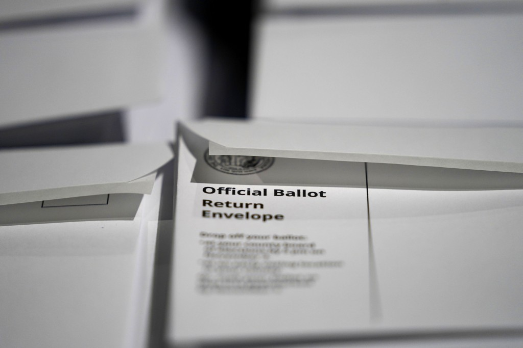 FILE - In this Sept. 3, 2020, file photo, stacks of ballot envelopes waiting to be mailed are seen at the Wake County Board of Elections in Raleigh, N...