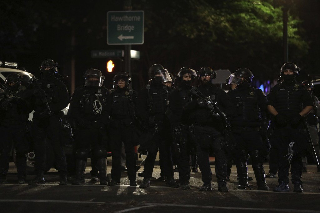 Portland Police line up to block from the street from protesters rallying at the Mark O. Hatfield United States Courthouse on Saturday, Sept. 26, 2020...